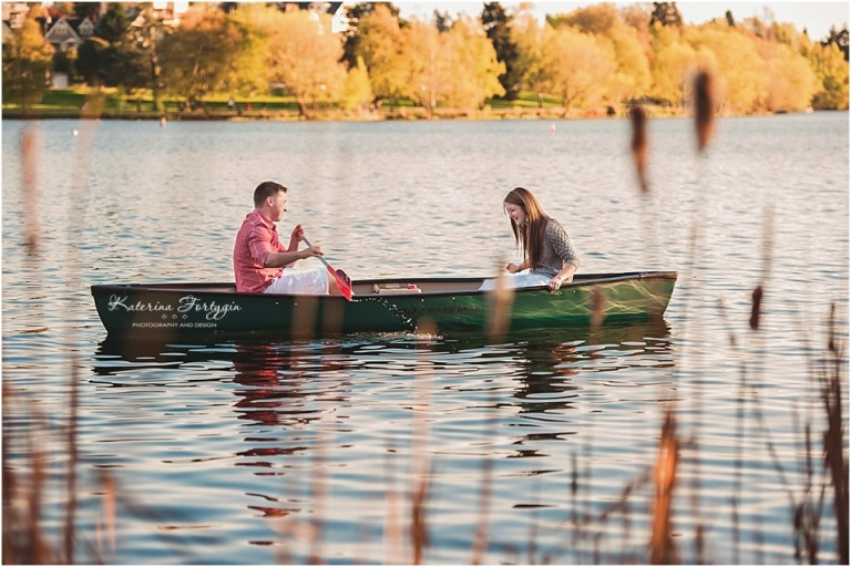 Green Lake Engagement session with fun couple riding a canoe captured by Katerina Fort